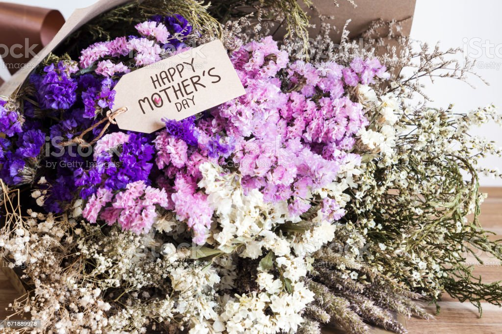 Bouquet of dried flowers with mothers day card on the wooden table stock photo