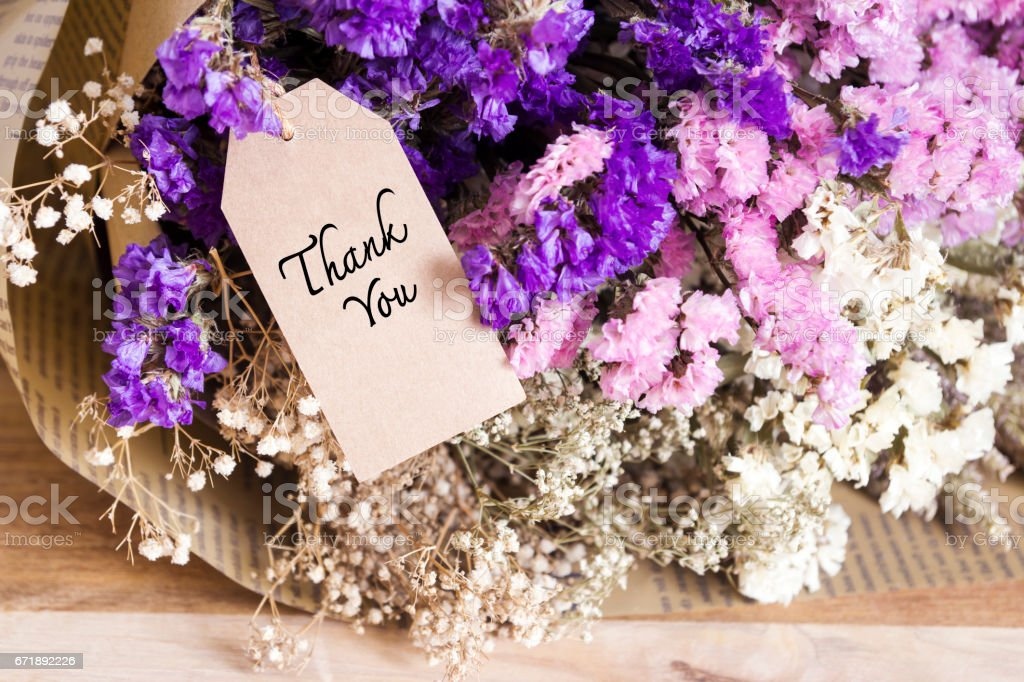 Bouquet of dried flowers with thank you card on the wooden table stock photo