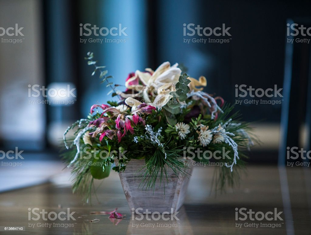 Bouquet of dry flowers in the vase on the table stock photo