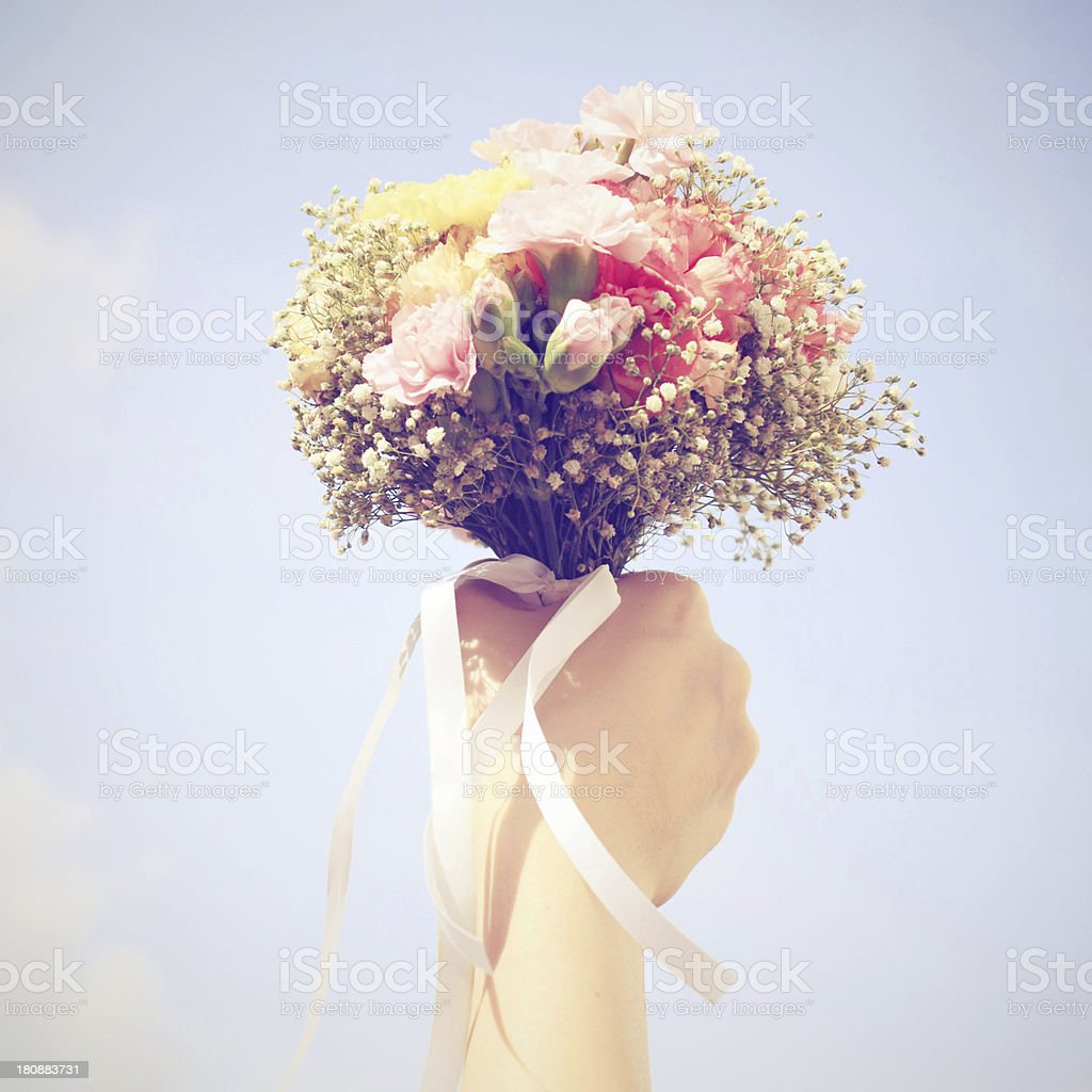 Bouquet of flower in hand and blue sky royalty-free stock photo
