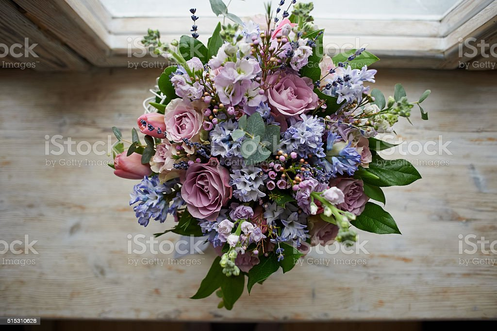 bouquet of flowers: green, blue, purple stock photo