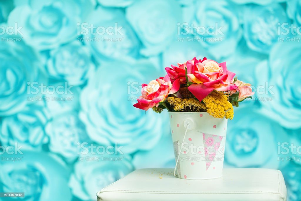 Bouquet of flowers in basket stock photo