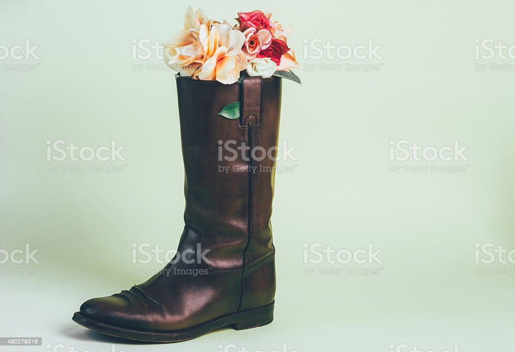Bouquet of flowers in boot royalty-free stock photo