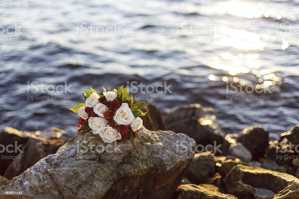 bouquet of flowers near the water stock photo