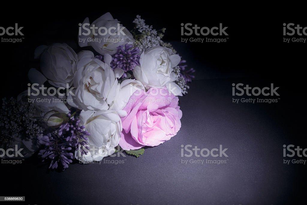Bouquet of flowers on black background. Wedding invitation card. stock photo