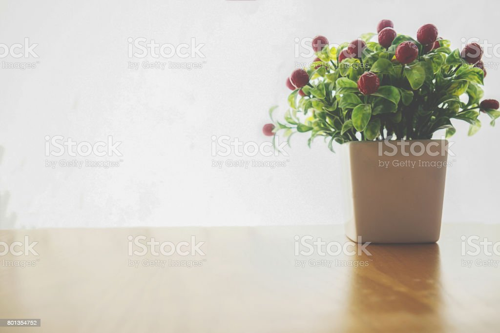 Bouquet of flowers on shelf in front of wall. View with copy space stock photo