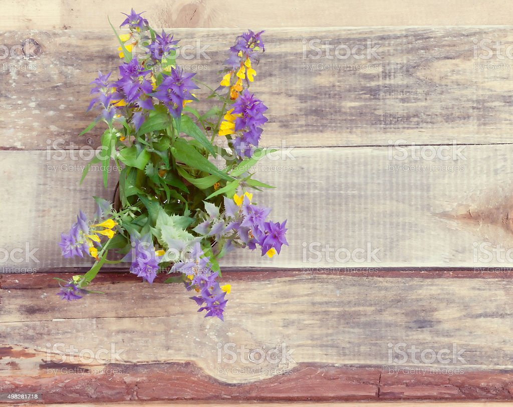 bouquet of flowers on the old boards stock photo