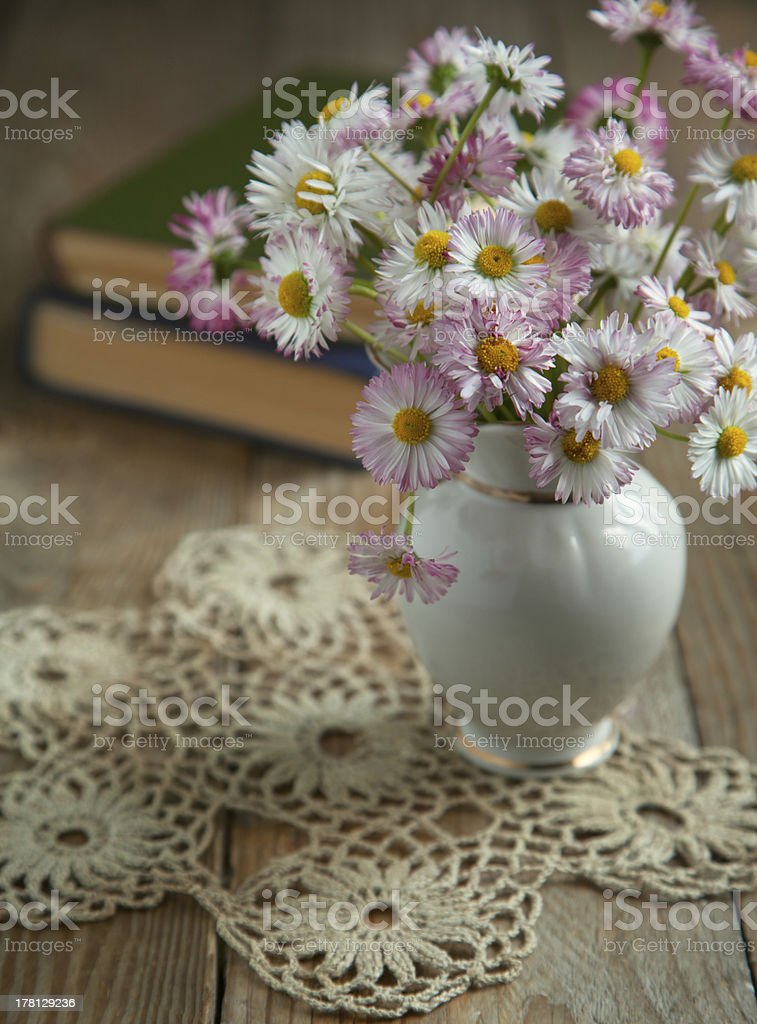Bouquet of flowers with books. Selective focus royalty-free stock photo