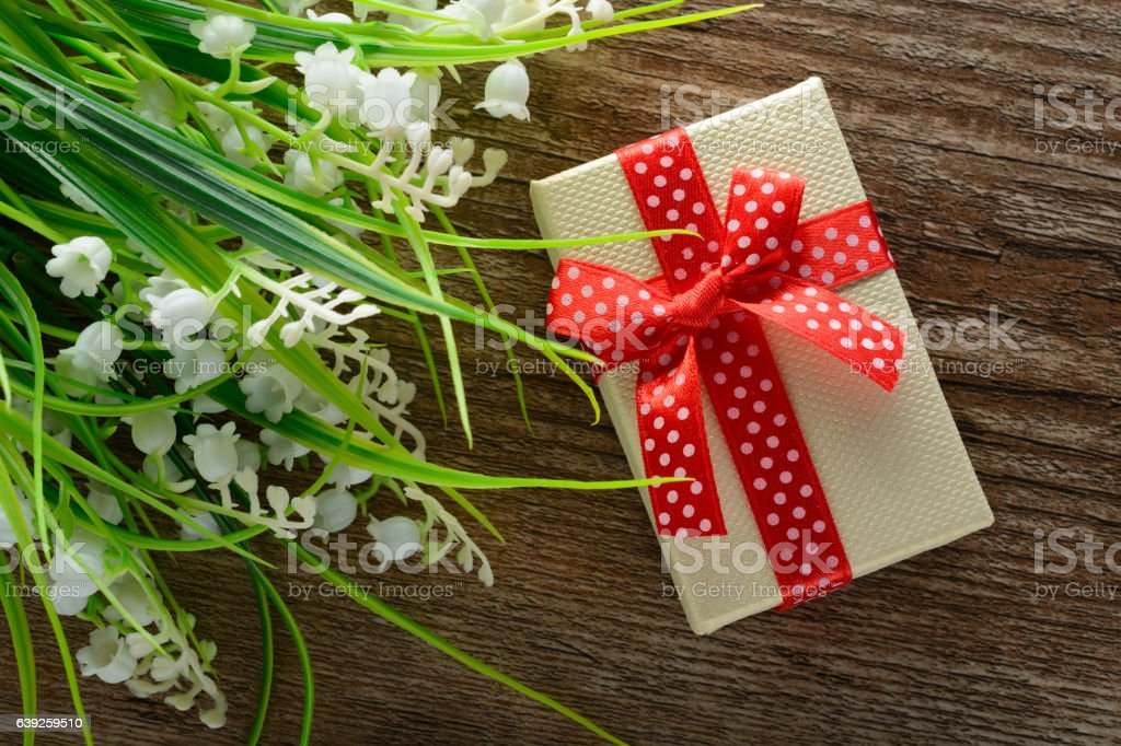 Bouquet of lily the valley and a gift stock photo