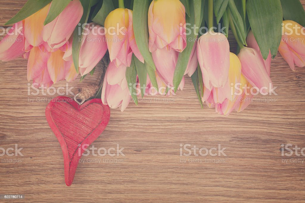 bouquet of multicolored   tulip flowers with heart stock photo
