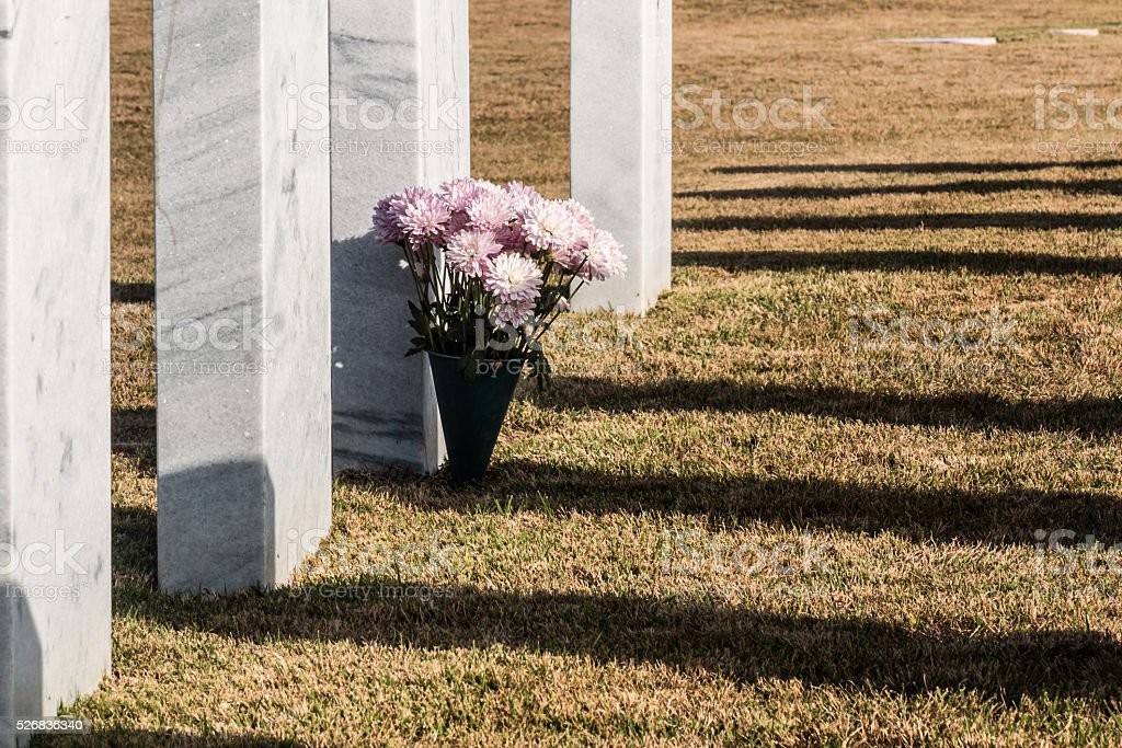 Bouquet of Pink Flowers on Grave at Miramar National Cemetery stock photo