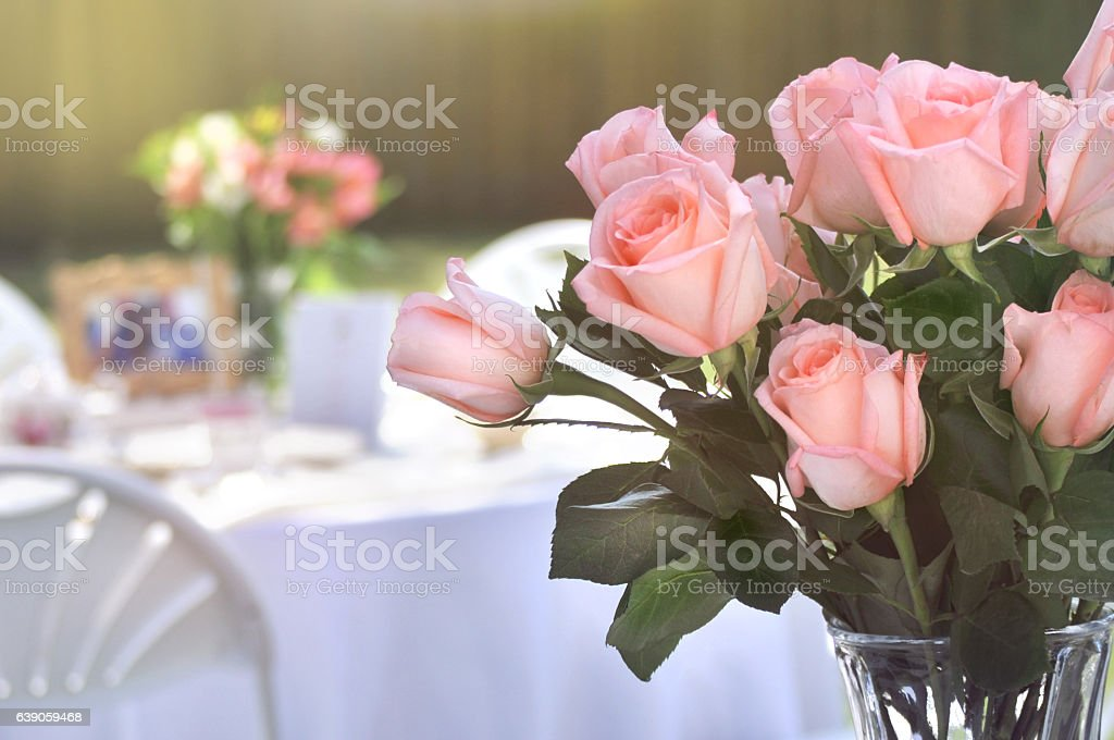 Bouquet of Pink Long Stem Roses in an Outdoor Setting stock photo