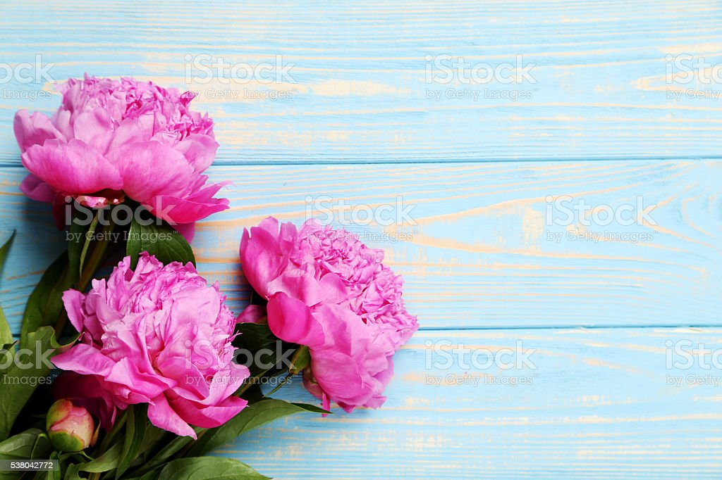 Bouquet of pink peony flowers on wooden table stock photo