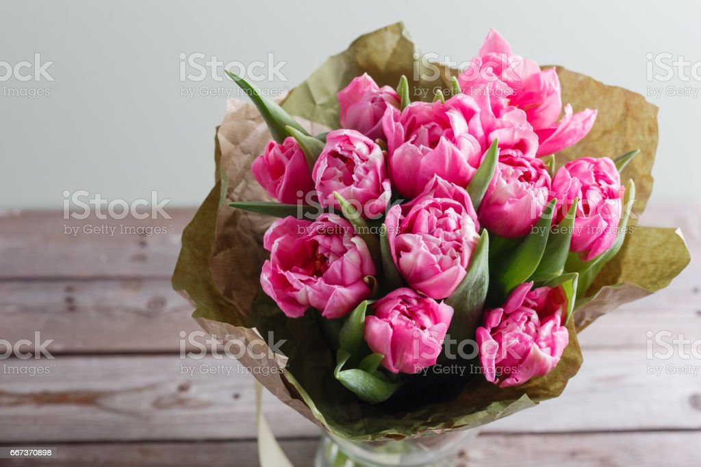 Bouquet of pink peony tulips on a wooden background. Spring flowers. Mother's Day background. stock photo