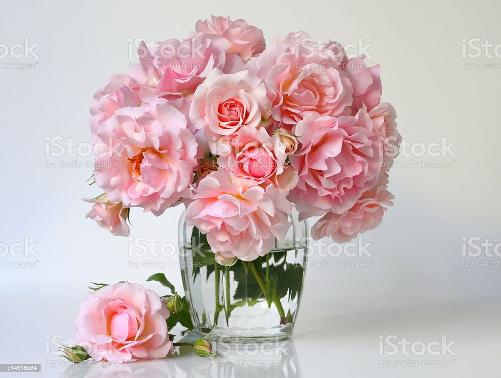 Bouquet of pink roses in a  vase. Romantic floral decoration. stock photo