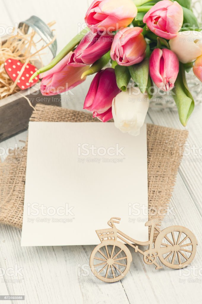 Bouquet of pink tulips with blank card stock photo