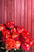 Bouquet of red roses on the wooden background