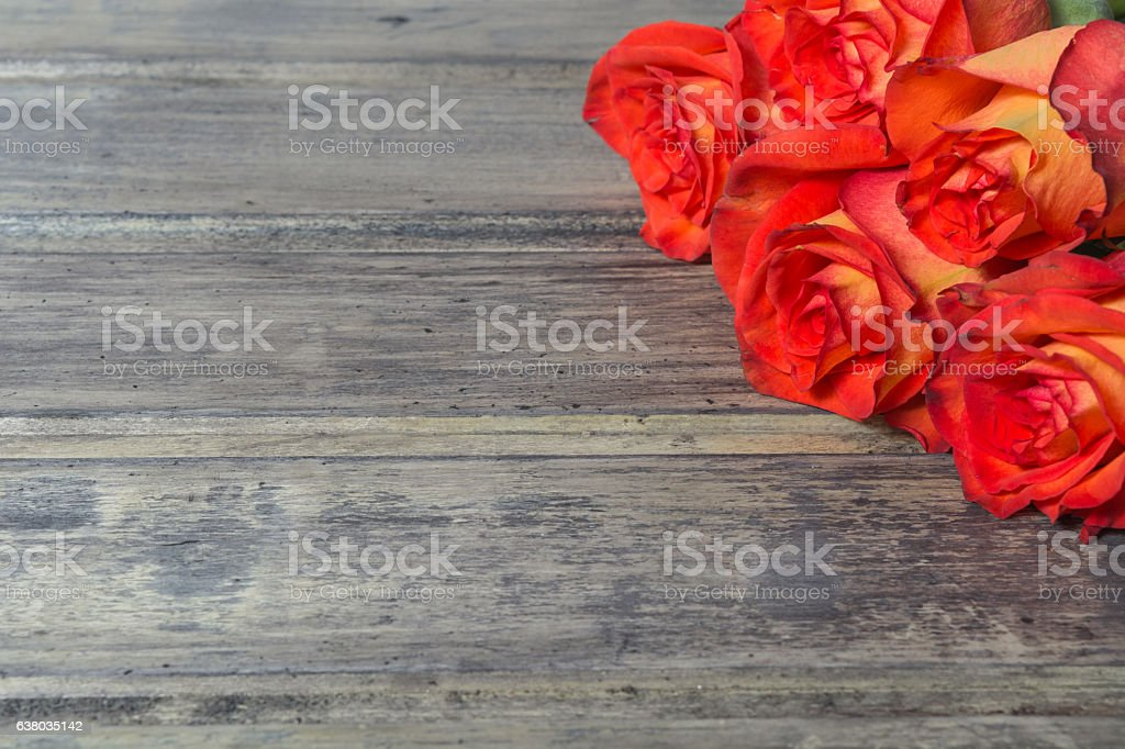 Bouquet of red roses on the wooden background stock photo