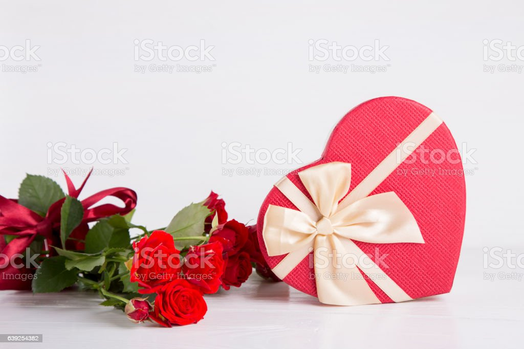 Bouquet of red roses with red gift box on white stock photo