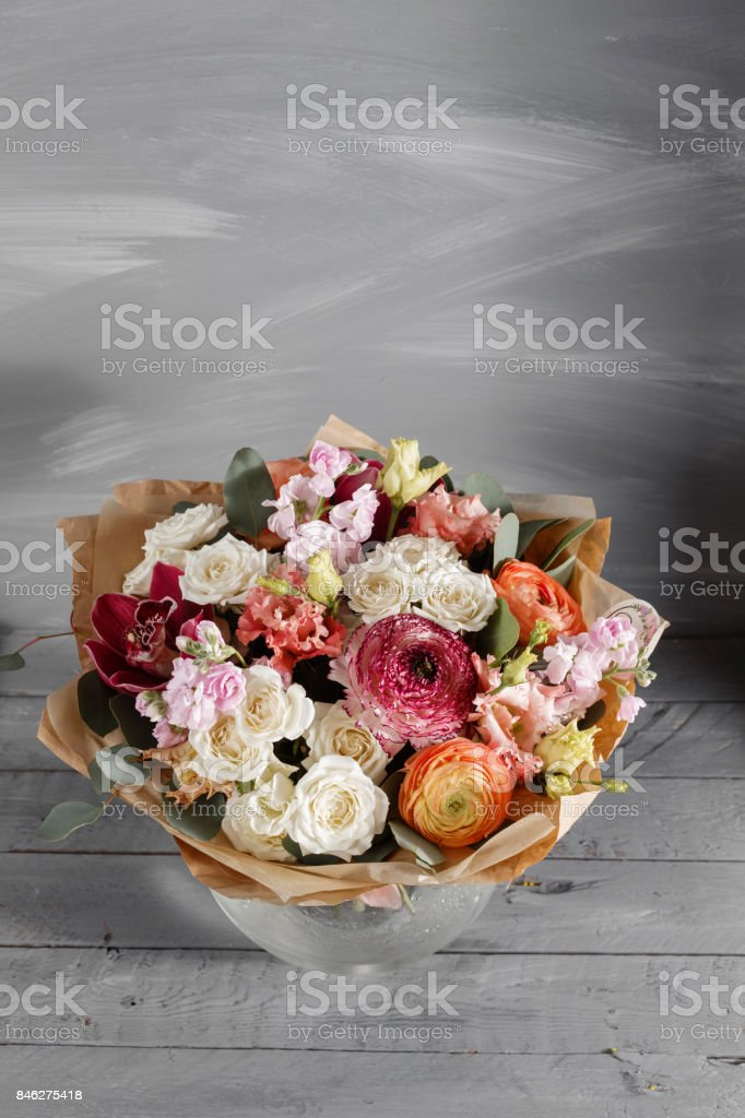 Bouquet of roses and Other colors flowers on wooden background, copy space. stock photo