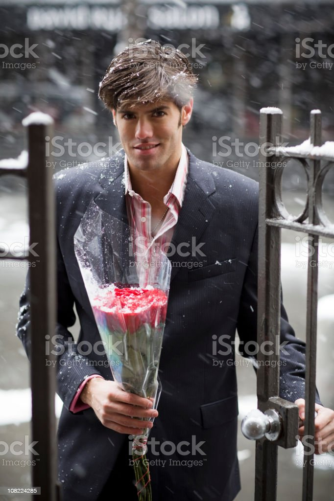 Bouquet of Roses from Handsome Young Man on Date, Copyspace royalty-free stock photo