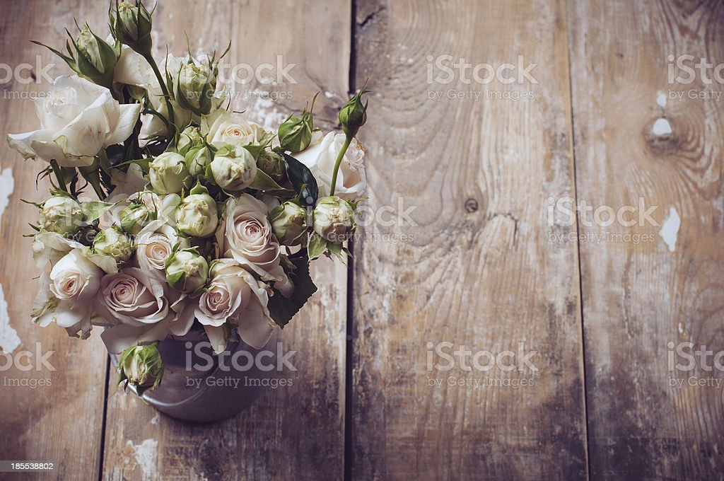 Bouquet of roses in metal pot stock photo
