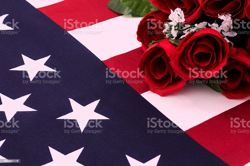 Bouquet of roses on American flag - close up stock photo