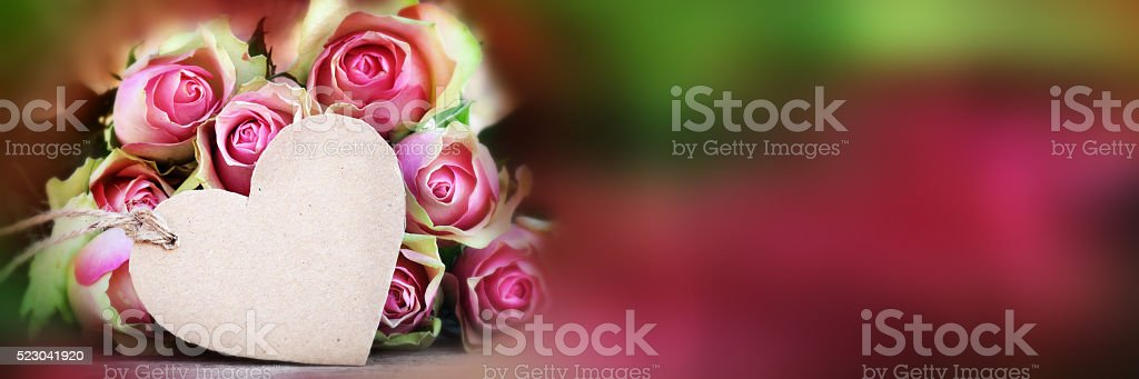 Bouquet of roses with a greeting card stock photo