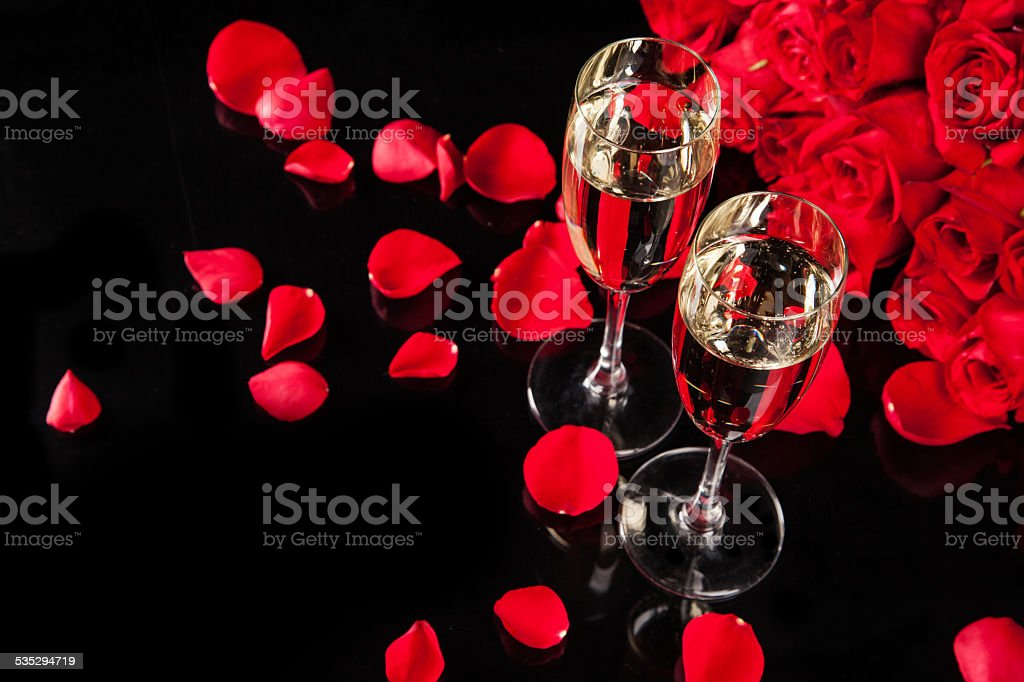 Bouquet of roses with champagne stock photo