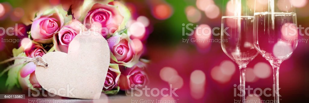 Bouquet of roses with heart and champagne stock photo