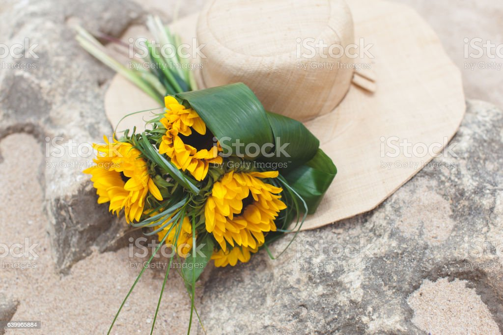 Bouquet of sunflowers and straw stock photo