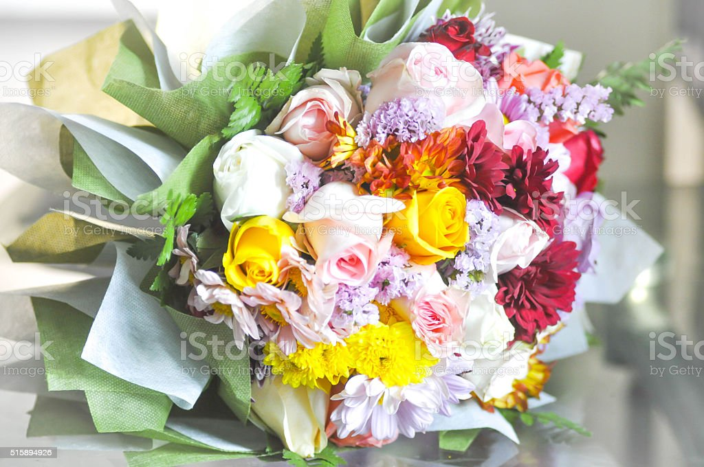 bouquet of white ,pink and yellow rose flowers stock photo