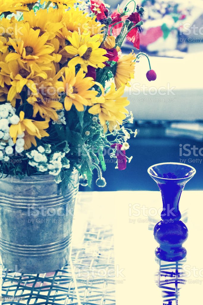 A bouquet of wildflowers on the table. stock photo