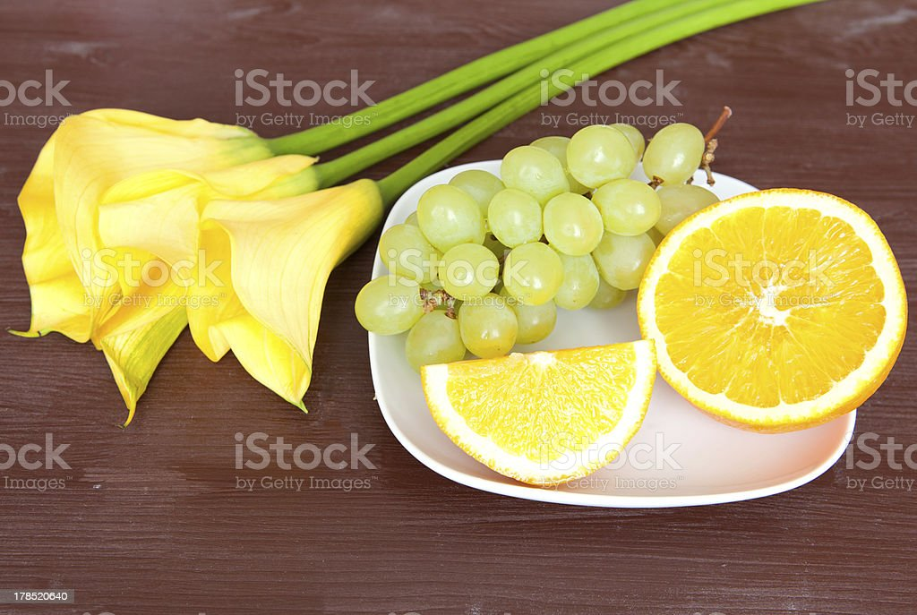 Bouquet of yellow callas with fruits royalty-free stock photo