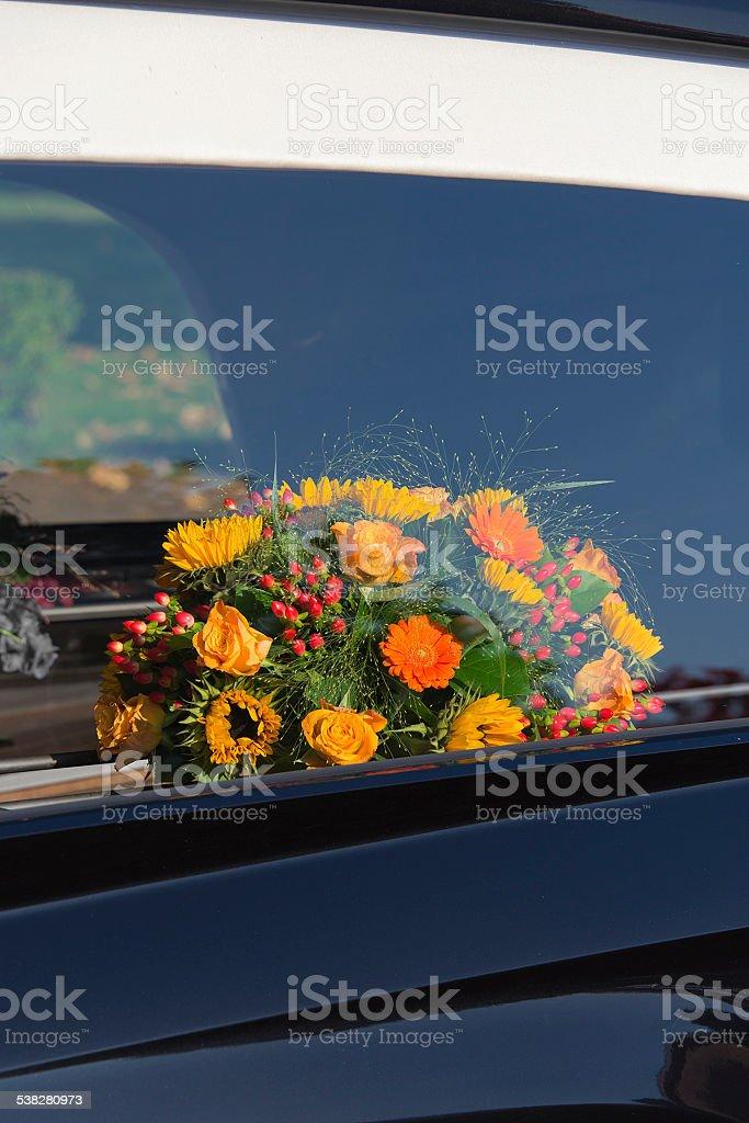 Bouquet through a Hearse Car Window stock photo