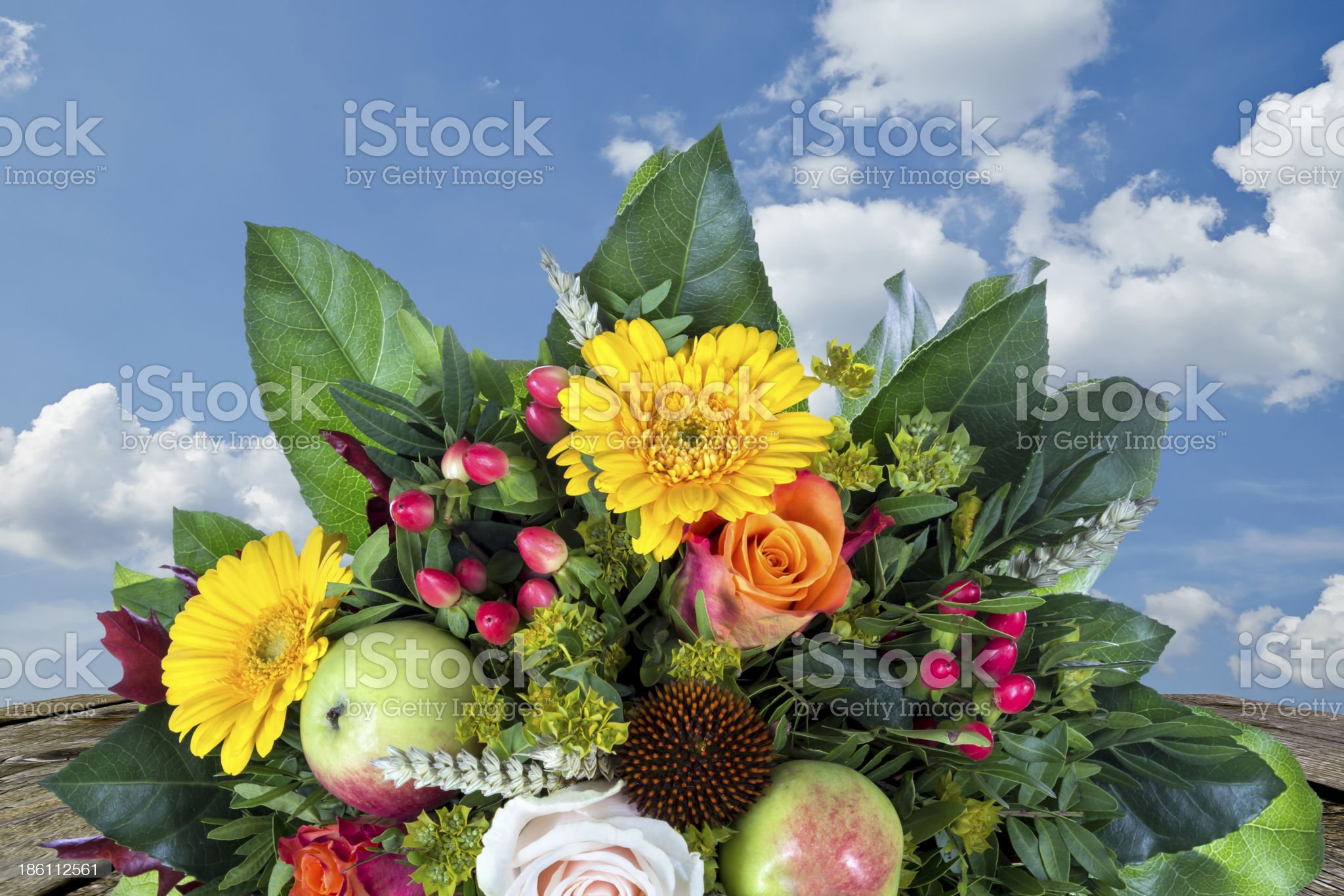 Bouquet with autumn decoration wooden table and blue sky royalty-free stock photo