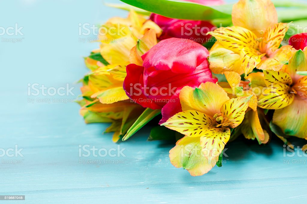 Bouquet yellow red spring flowers on vintage blue wood background bouquet yellow red spring flowers on vintage blue wood background royalty free stock mightylinksfo
