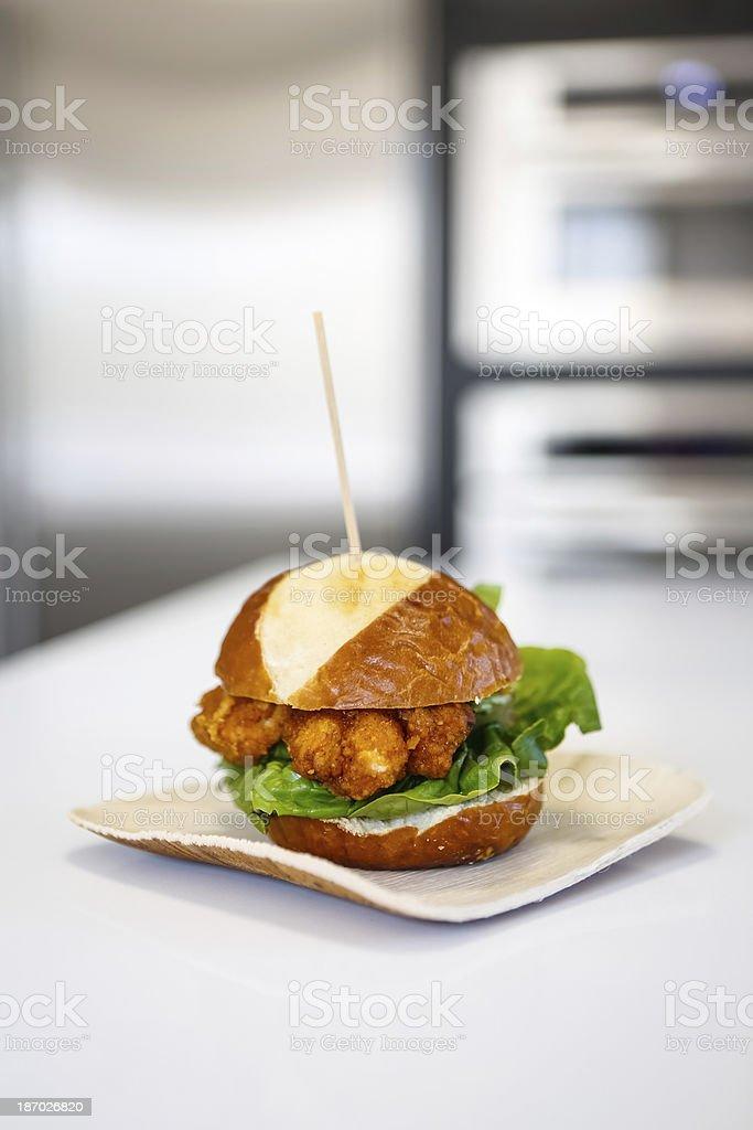 Bourbon Glazed Herb Chicken Pretzel Bread Slider stock photo