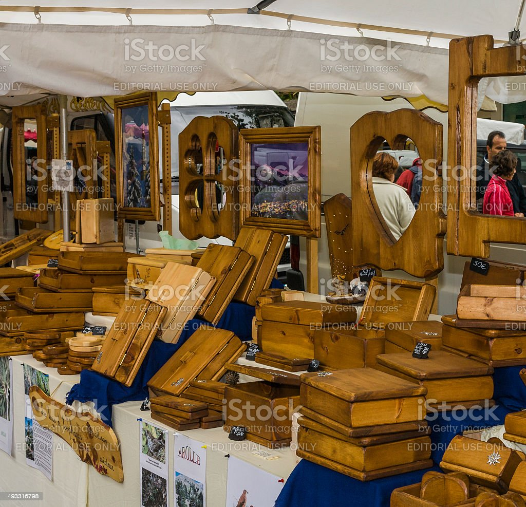 Bourg-Saint-Maurice, France. Wooden items for sale during a craft fair stock photo