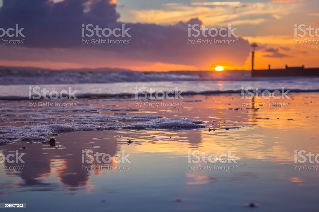 Bournemouth Beach at Sunset with Foam Detail stock photo