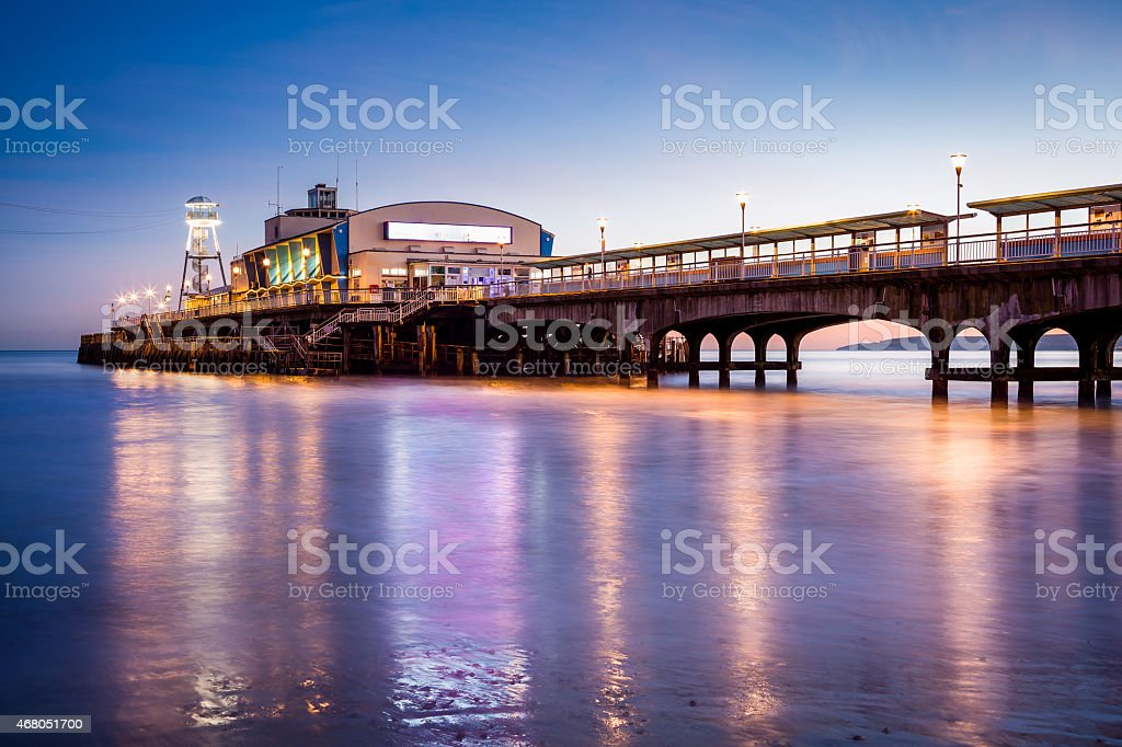 Bournemouth Pier at night Dorset stock photo
