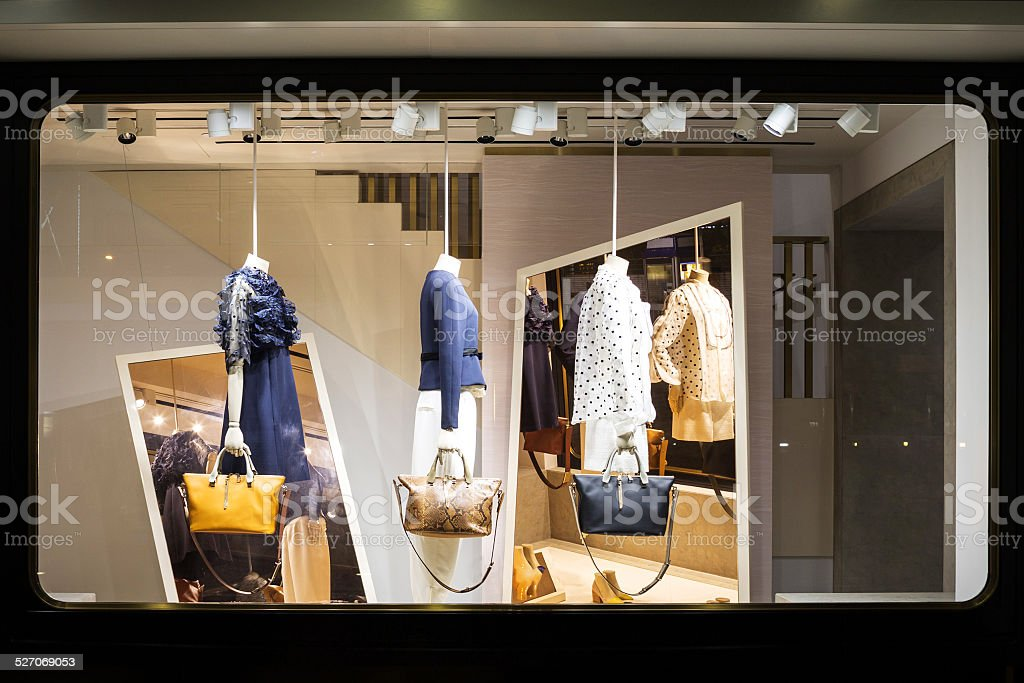boutique fashion display window in shop stock photo