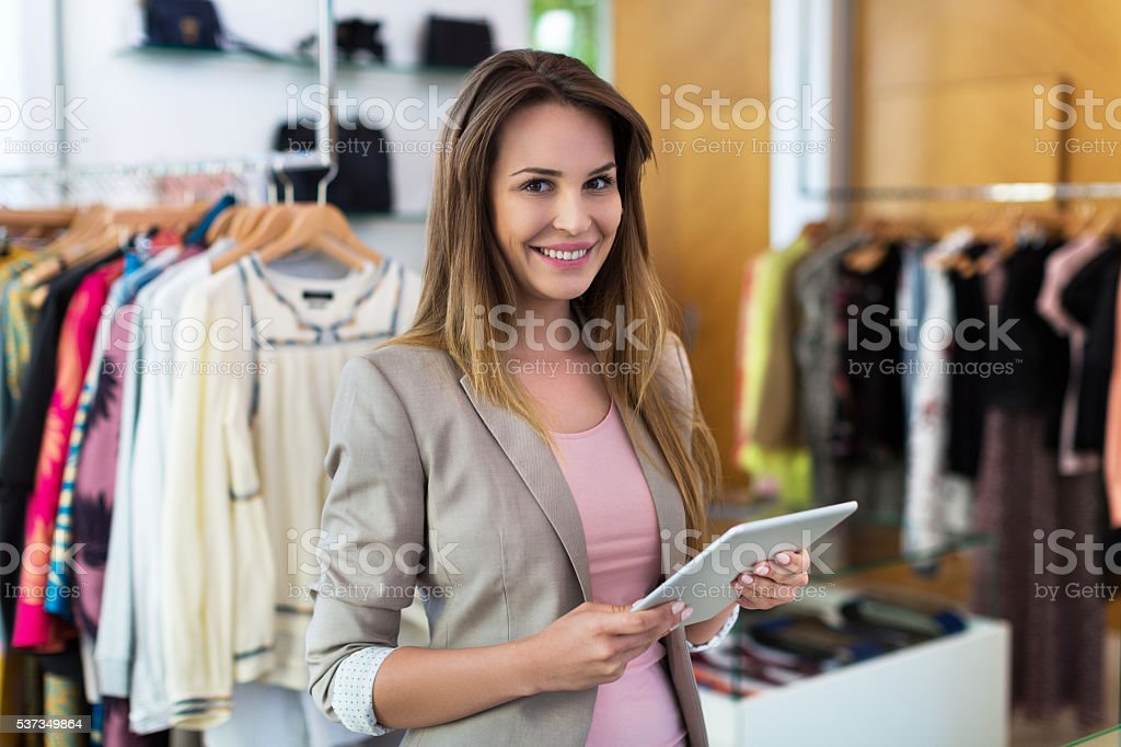 Boutique owner using a digital tablet stock photo