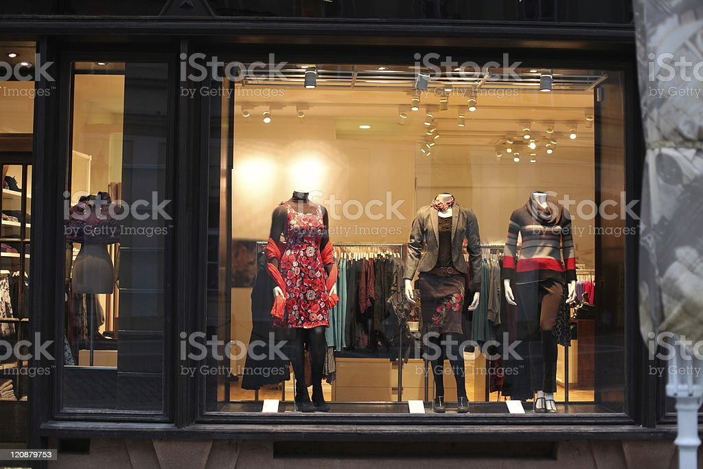 Boutique window with dressed mannequins stock photo
