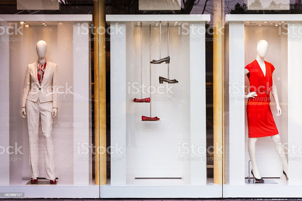 Boutique window with shoes, bags and mannequin stock photo