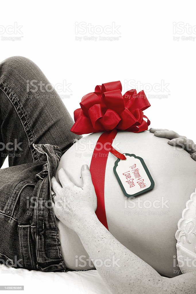 Bow and Note on Pregnant Belly royalty-free stock photo