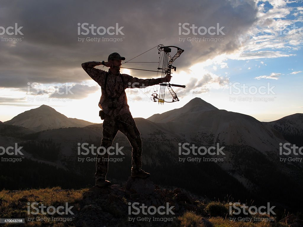 bow hunter silhouette stock photo