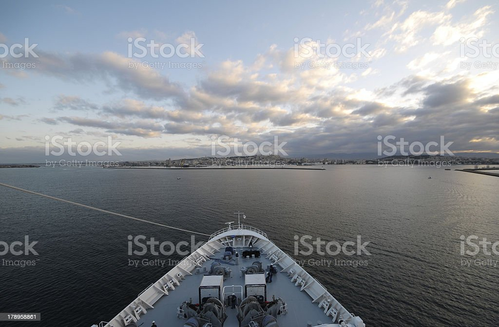 bow of a ship addind the coast line royalty-free stock photo