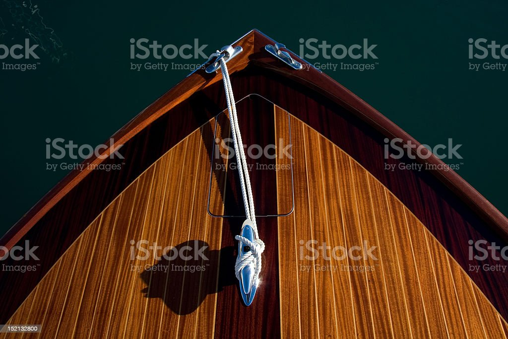 Bow of classic varnished motor yacht stock photo