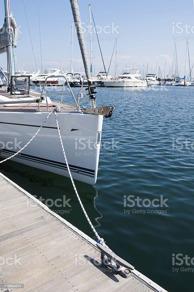 Bow of sailboat at marina royalty-free stock photo